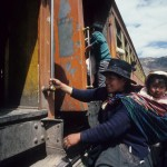 Mother & child boarding Andes train in Peru